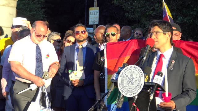 attendees listen to speakers and hold candles during an evening vigil memorial service for those killed and injured in the pulse nightclub in... - mexican american stock videos & royalty-free footage