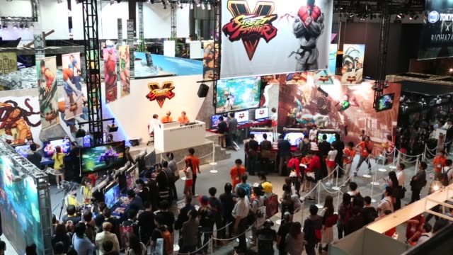 stockvideo's en b-roll-footage met attendees look at a display of a character from capcom co.'s biohazard video game at the tokyo game show 2015 at makuhari messe in chiba, japan, on... - television game show