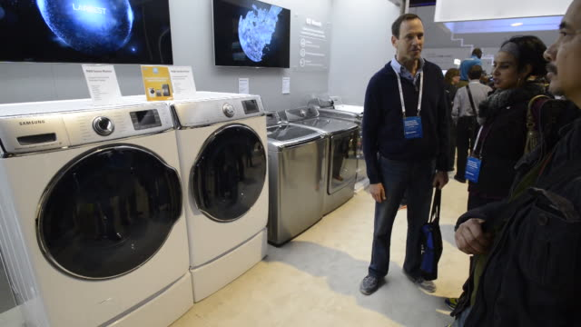 attendees looking at high tech refrigerators at the 2014 consumer electronics show in las vegas nevada us on thursday jan 9 samsung representative... - washer stock videos and b-roll footage