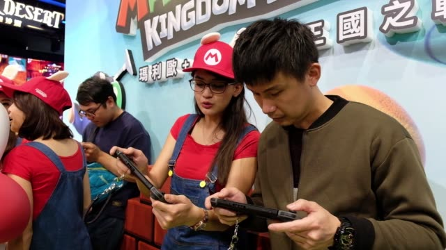 attendees play a game of nintendo co. mario+rabbids kingdom battle on nintendo switch video game consoles during the 2018 taipei game show in taipei,... - game show stock videos & royalty-free footage