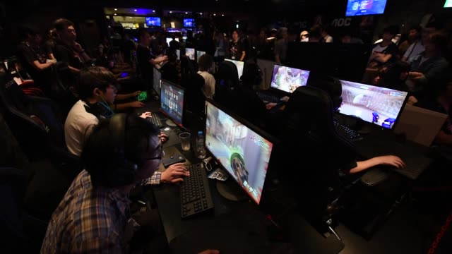 attendees play activision blizzard inc's overwatch computer game at the aoc open esports event in tokyo japan on saturday july 1 2017 - contestant stock videos & royalty-free footage