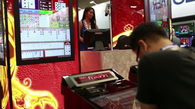 ws attendees play at a blackjack table ms an attendee plays on an shfl fusion electronic gaming table ws a dealer sits at a baccarat table ms a... - blackjack stock videos and b-roll footage