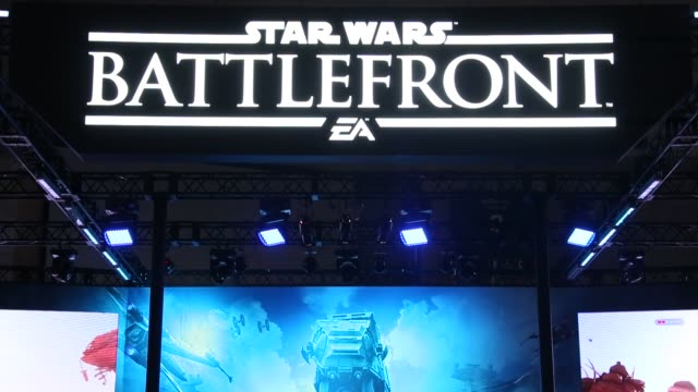 stockvideo's en b-roll-footage met attendees play electronic arts inc.'s star wars battlefront video game on sony corp.'s playstation 4 game consoles at the tokyo game show 2015 at... - television game show