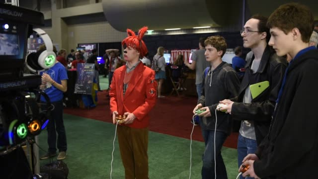 attendees play games during the south by southwest interactive festival in austin texas us a teen gamer plays a computer game using a keyboard and... - semi circle stock videos & royalty-free footage