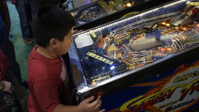 attendees play games during the south by southwest interactive festival in austin texas us close up shots of a pair of hands mashing buttons and... - pinball machine stock videos & royalty-free footage