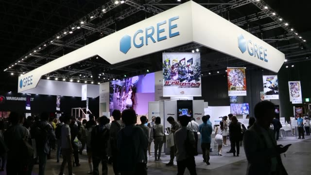 attendees play games on smartphones in the gree inc booth at the tokyo game show 2014 in chiba, japan, the the gree inc booth is seen at the tokyo... - game show stock videos & royalty-free footage