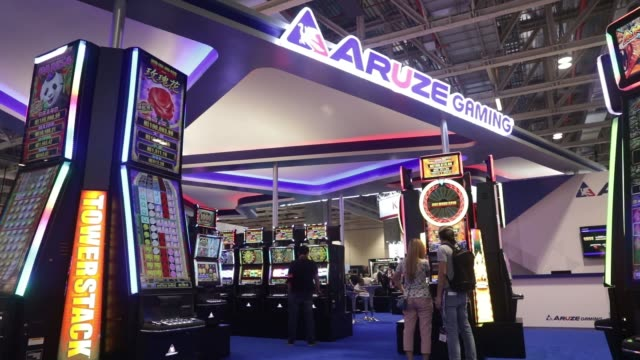 attendees play slot machines at the global gaming expo inside the venetian macau resort and casino operated by sands china ltd a unit of las vegas... - cotai strip stock videos and b-roll footage