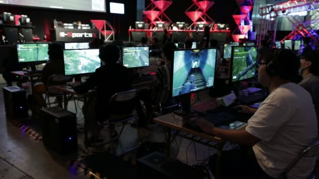 stockvideo's en b-roll-footage met attendees play the playerunknown's battlegrounds multiplayer online video games, developed by bluehole studio inc., during an e-sports event at the... - television game show
