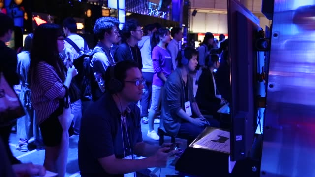 attendees play video games on the playstation 4 video game console in the sony interactive entertainment booth during the tokyo game show 2018 on... - television game show stock videos & royalty-free footage