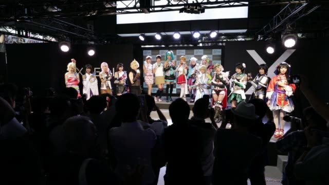 stockvideo's en b-roll-footage met attendees play video games wearing virtual reality headsets at the tokyo game show 2017 at makuhari messe in chiba, japan, on friday, sept. 22 booth... - television game show