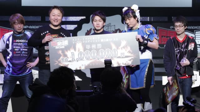 Attendees react as a pro gamer right wins a final match of Capcom Co's Street Fighter game during the Tokaigi Game Party Japan esports competition at...