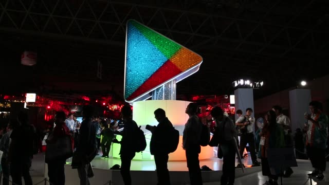 stockvideo's en b-roll-footage met attendees stand in front of the google play booth during the tokyo game show 2018 on september 21, 2018 in chiba, japan. - television game show