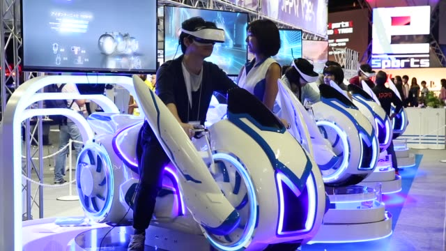 stockvideo's en b-roll-footage met attendees try photon bike virtual reality attractions in the jppvr booth during the tokyo game show 2018 on september 21, 2018 in chiba, japan. - television game show