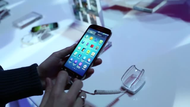 Attendees view and handle black versions of the new Samsung Electronics Co Galaxy S4 smartphone during a launch event at Radio City Music Hall in New...