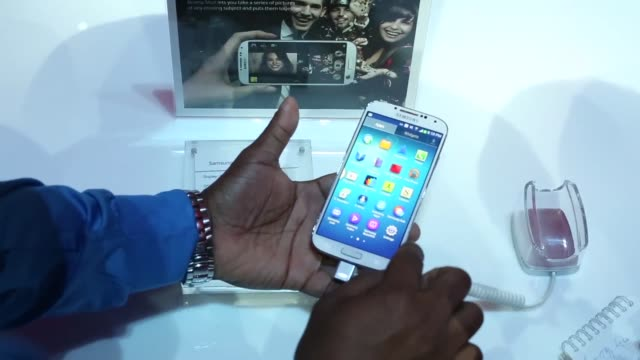 Attendees view and handle white versions of the new Samsung Electronics Co Galaxy S4 smartphone during a launch event at Radio City Music Hall in New...