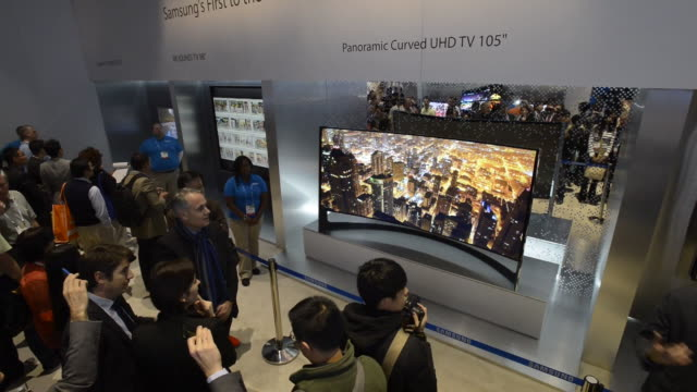 attendees viewing samsung curved uhdtv's displayed at the 2014 consumer electronics show in las vegas, nevada, u.s., on thursday, jan. 9 wide shot of... - inch stock videos & royalty-free footage