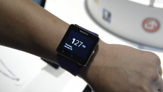 attendees viewing sony tablets at the 2014 consumer electronics show in las vegas, nevada, u.s., on thursday, jan. 9 close up of attendees viewing... - wrist watch stock videos & royalty-free footage