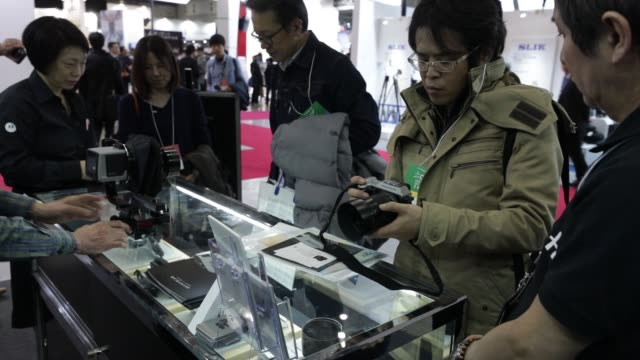 Attendees visit the Hasselblad Japan booth at the CP Camera and Photo Imaging Show in Yokohama Kanagawa Prefecture Japan on Friday Feb 24 The Victor...