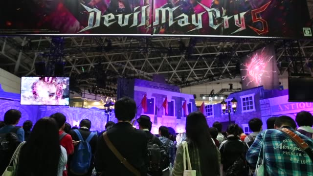 stockvideo's en b-roll-footage met attendees wait to enter the capcom co.'s devil may cry 5 booth during the tokyo game show 2018 on september 21, 2018 in chiba, japan. - television game show