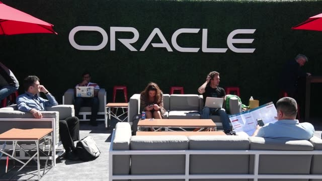 attendees walk around outdoor area at oracle openworld 2017 conference in san francisco california us on monday oct 2 2017 photographer david paul... - oracle corporation stock-videos und b-roll-filmmaterial