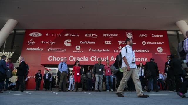 attendees walk by entrance to oracle openworld 2017 conference in san francisco california us on monday oct 2 2017 photographer david paul morris... - oracle corporation stock-videos und b-roll-filmmaterial