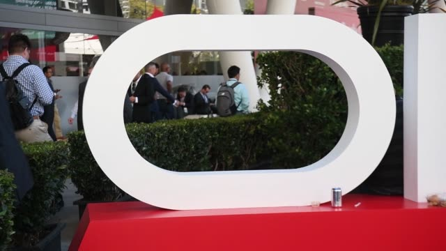 attendees walk by large oracle sign posted in outdoor area of oracle openworld 2017 conference in san francisco california us on monday oct 2 2017... - oracle corporation stock-videos und b-roll-filmmaterial