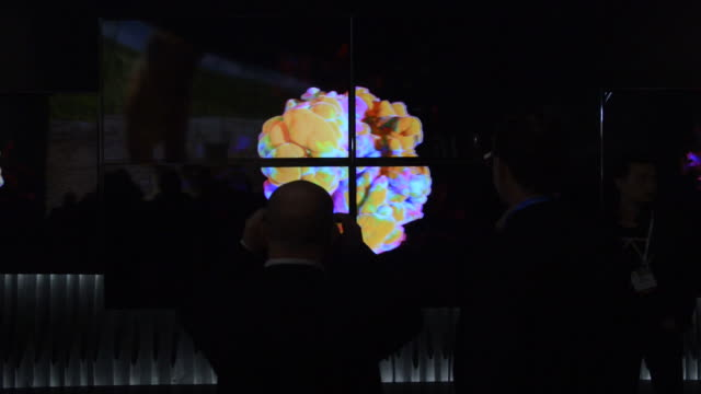 attendees walk past lg electronics inc ultra high definition 4k screens displayed at the 2014 consumer electronics show in las vegas nevada us on... - liquid crystal display television stock videos and b-roll footage