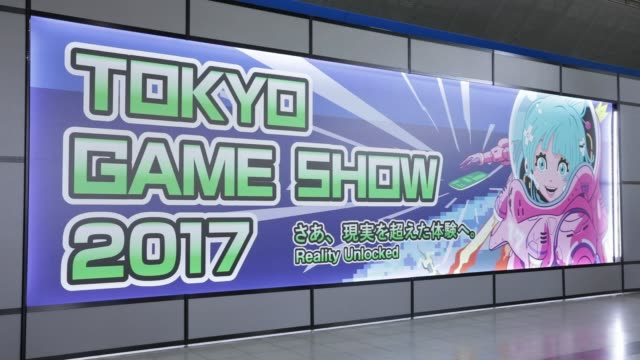attendees walk past signage at the tokyo game show 2017 at makuhari messe in chiba, japan, on friday, sept. 22 attendees enter the venue, attendees... - game show stock videos & royalty-free footage