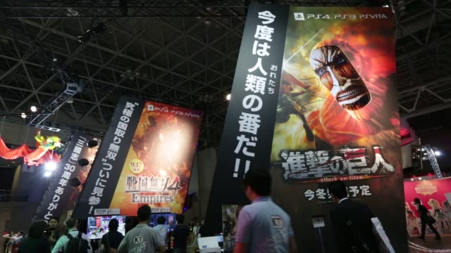 stockvideo's en b-roll-footage met attendees walk past the koei tecmo games co. booth at the tokyo game show 2015 at makuhari messe in chiba, japan, on friday, sept. 18, 2015. shots:... - television game show