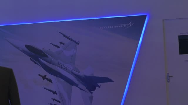 Attendees walk past the Lockheed Martin Corp booth during the Aero India air show at Air Force Station Yelahanka in Bengaluru India on Thursday Feb...