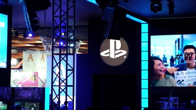 attendees walk past the sony corp playstation booth during the 2018 taipei game show in taipei taiwan on friday jan 26 signage for playstation is... - game show stock videos & royalty-free footage