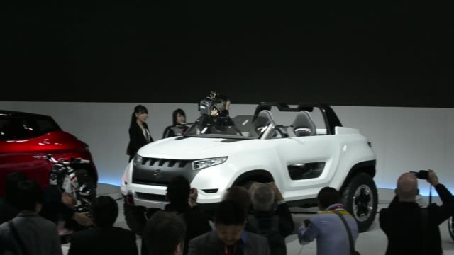 attendees walk past the suzuki motor corp. booth at the 43rd tokyo motor show 2013 in tokyo, japan, on wednesday, nov. 20 suzuki motor corp. logo,... - 2013 stock videos & royalty-free footage