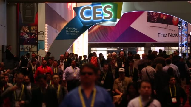 attendees walk through the entrance and through show floor during the 2017 consumer electronics show in las vegas, nevada, u.s. on friday, jan. 6,... - tradeshow stock videos & royalty-free footage