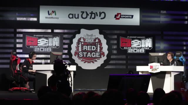 Attendees watch as pro gamers play Capcom Co's Street Fighter game during the Tokaigi Game Party Japan esports competition at the Makuhari Messe...