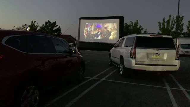 attendees watch the movie the goonies at a popup drivein theatre built in the parking lot at the broadway commons on may 21 2020 in hicksville new... - finance and economy stock videos & royalty-free footage