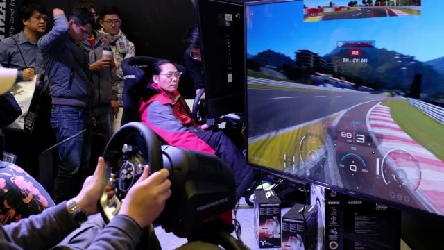 attendees wearing kingston technology corp. hyperx cloud headsets play a game of street fighter v, developed by capcom co. and dimps corp., during... - game show stock videos & royalty-free footage