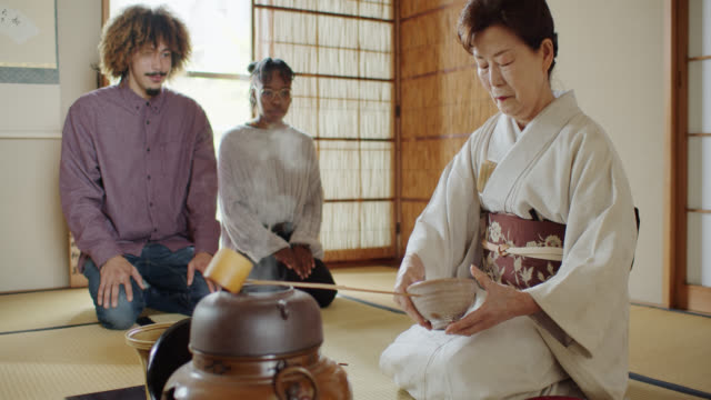 attentive tea ceremony guests watching hostess wiping bowls - washitsu stock videos and b-roll footage