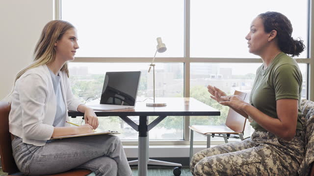 attentive therapist counsels female soldier - military uniform stock videos & royalty-free footage