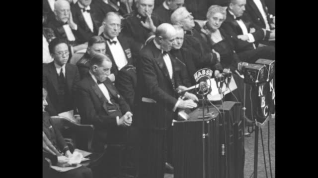 us attorney general homer cummings speaks at podium in madison square garden [she] has born the lamp of hope into the house of hunger she has carried... - generalstaatsanwalt stock-videos und b-roll-filmmaterial