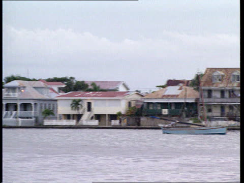 attorney general on privy council in belize tx 211293 itn harbour with boats about and people about in streets - generalstaatsanwalt stock-videos und b-roll-filmmaterial