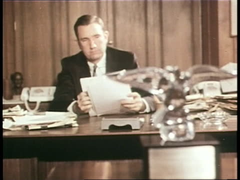 us attorney general ramsey clark signs documents in his office in washington dc - department of justice stock videos & royalty-free footage