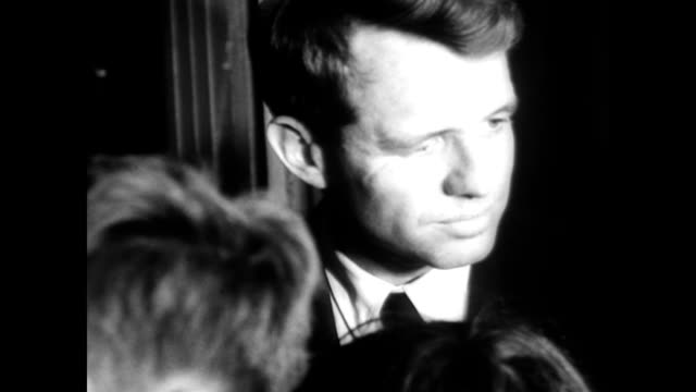 / attorney general robert f kennedy and family surrounded by 15000 polish people on the streets of krakow / ethel kennedy receives flowers and the... - generalstaatsanwalt stock-videos und b-roll-filmmaterial