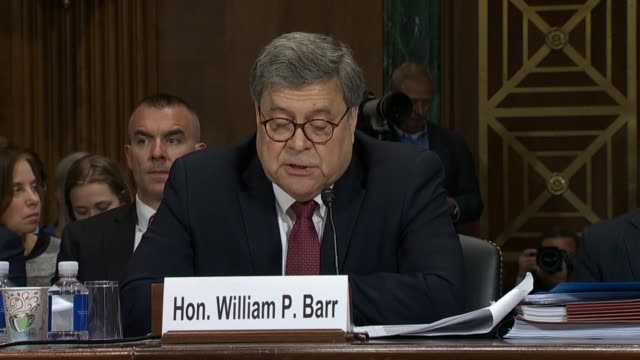 Attorney General William Barr reads from a prepared statement at a Senate Judiciary Committee hearing on the report of special counsel Robert Mueller...