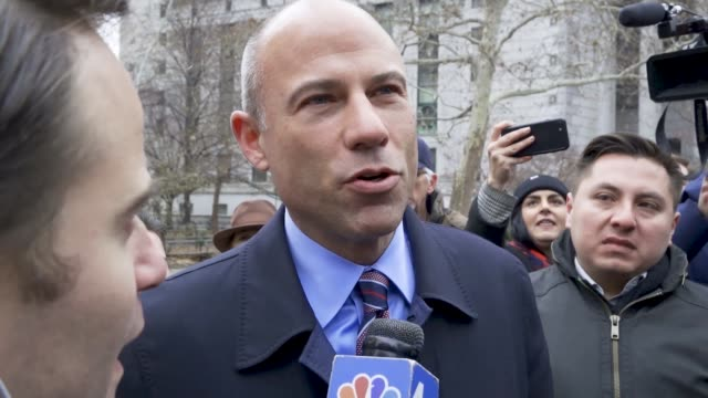 attorney michael avenatti exiting the court house and responding to reporters questions regarding michael cohen's thee year prison sentence earlier... - stormy daniels video bildbanksvideor och videomaterial från bakom kulisserna