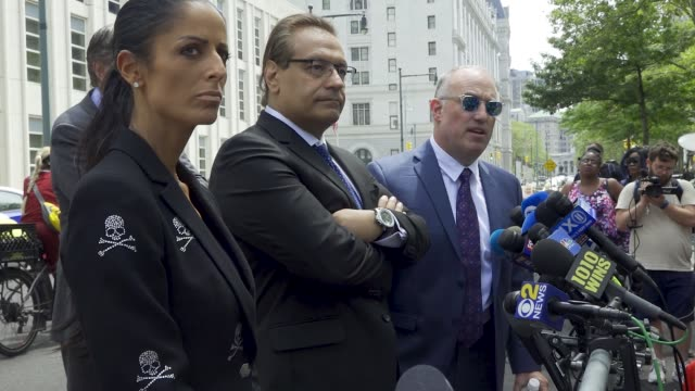 attorneys douglas anton and steve greenberg speak to reporters after r kelly's brooklyn federal court's second hearing r kelly is an american singer... - trafficking stock videos & royalty-free footage