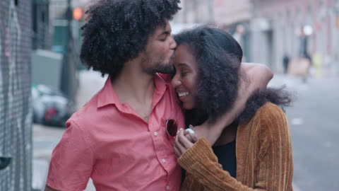 attractive african american couple walk and show affection on urban street - flirting stock videos & royalty-free footage