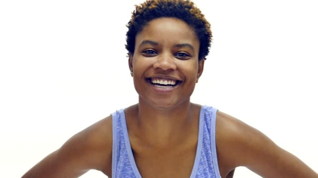 attractive african american woman smiling - white background stock videos & royalty-free footage