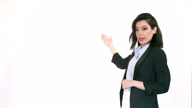 attractive and presentable asian multi-ethnic woman making presentation in front of white background. (version 2) - presenter stock videos & royalty-free footage