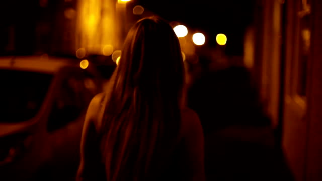 attractive beautiful young blonde woman in short skirt walks city street alone at night - following stock videos & royalty-free footage