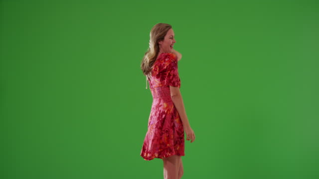 attractive blonde female in sundress dancing on green screen - entertainment occupation stock videos and b-roll footage